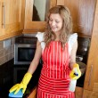 Stock Photo: Smiling woman doing housework