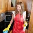 Stock Photo: Smiling womdoing housework