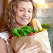Stock Photo: Charming woman holding a grocery bag