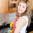 Positive woman doing the dishes - Stock Photo