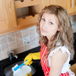Unhappy woman doing the dishes — Stock Photo