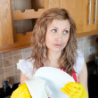 Stock Photo: Attractive young woman drying dishes