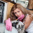 Stock Photo: Tired cute womfiling dishwasher