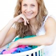 Happy woman doing laundry — Stock Photo