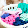 Stock Photo: Close-up of young womdoing laundry