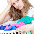 Tired woman doing laundry - Stock Photo