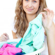 Stock Photo: Upset womdoing laundry