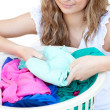 Stock Photo: Attractive womdoing laundry