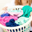 Stock Photo: Close-up of caucasiwomdoing laundry