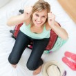 Successful woman trying to close her suitcase - Stockfoto