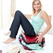 Attractive woman trying to close her suitcase — Stock Photo