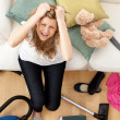 Stock Photo: Stressed young womdoing housework
