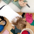 Stock Photo: Blond womdoing housework