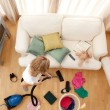 Stock Photo: Blond woman vacuuming the living-room