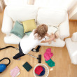 Blong young woman doing housework - Stock Photo