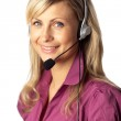 Young business woman talking on a headset — Stock Photo #10306924