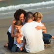 Happy family on a beach - Stock Photo