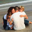 Happy family on a beach — Stock Photo #10307335