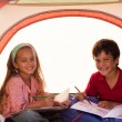 Kids drawing in a tent — Stock Photo #10307527