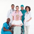 Doctors with a patient in a wheel chair — Stock Photo