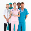 Team of doctors smiling at the camera — Stock Photo