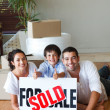 Family on the floor with boxes after buying house — Stock Photo