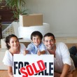 Family on the floor with boxes after buying house — Stock Photo #10307990