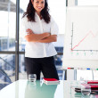 Confident businesswoman before giving a presentation with crosse — Stock Photo