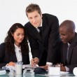 Young businessman working with his team — Stock Photo #10308540
