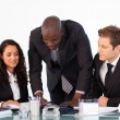 African businessman talking to his team — Stock Photo #10308550