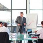 Senior businessman in a presentation — Stock Photo