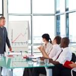 Senior businessman interacting with his team — Stock Photo