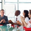 Business applauding in a meeting — Stock Photo