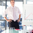 Young businessman standing in a presentation — Stock Photo