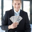 Stock Photo: Businessmholding dollars