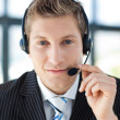 Handsome oung businessman with a headset on — Stock Photo