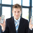 Attractive businessman holding dollars - Foto Stock