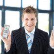 Stock Photo: Smiling businessmholding dollars