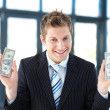 Stock Photo: Young businessmholding money