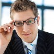 Stock Photo: Businessmlooking to camerwith glasses