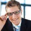 Stock Photo: Businessmlooking to camerwearing glasses
