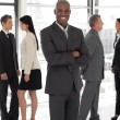 Smiling ethnic business leader - Stock Photo