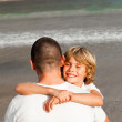 Son and father hugging on the beach — Stock Photo