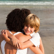 Little boy and his mother having a hug on the beach — 图库照片