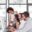 Stock Photo: Female leader managing her team in call center