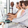 Ethnic businessman working in a call center — Stock Photo #10309136