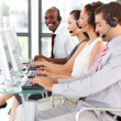 Ethnic businessman working in a call center — Stock Photo