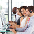 Stock Photo: African-Americbusinesswomworking in call center