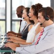 Smiling young businessman in a call center — Stock Photo
