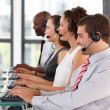 Smiling young businessman in a call center — Stock Photo #10309150